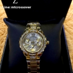 GUESS Women's W0111L2 Sparkling Hi-Energy Mid-Size Gold-Tone Watch