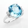 แหวนพลอยแท้ แหวนเงินแท้925 พลอยโทปาสสีฟ้า สีสวยโดดเด่น ล้อมด้วยเพชร CZ ชุบทองคำขาว