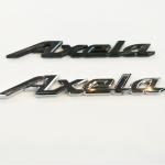 โลโก้ Axela Mazda 3