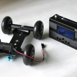 Motorized desktop dolly for DSLR for motion control time lapse and real time video